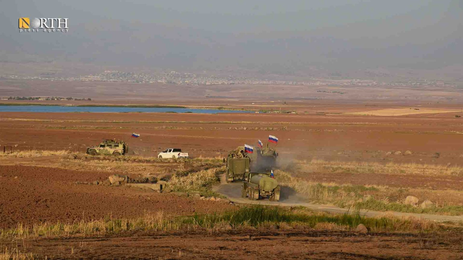A Russian patrol withdraws from Derik countryside, north Syria, after residents' protest- North Press