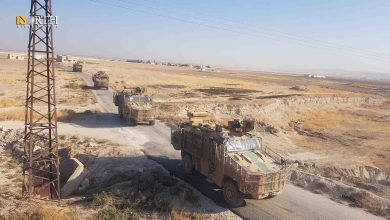 Photo of Russian and Turkish forces conduct joint patrol in Syria's Kobani