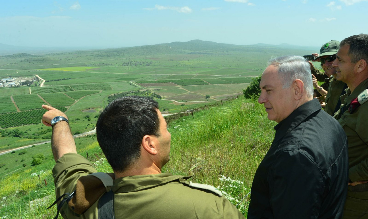 The Israeli Prime Minister stands on the Golan Heights