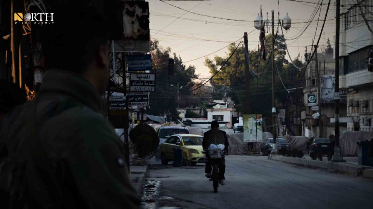 Qamishli, a member of the Internal Security Forces (Asayish) opposite to a Syrian government checkpoint – North Press