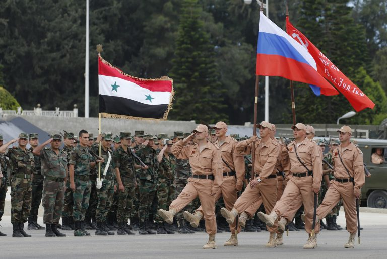 Syrian and Russian soldiers during a march in preparation for a military parade at Hmeimim Air Base.