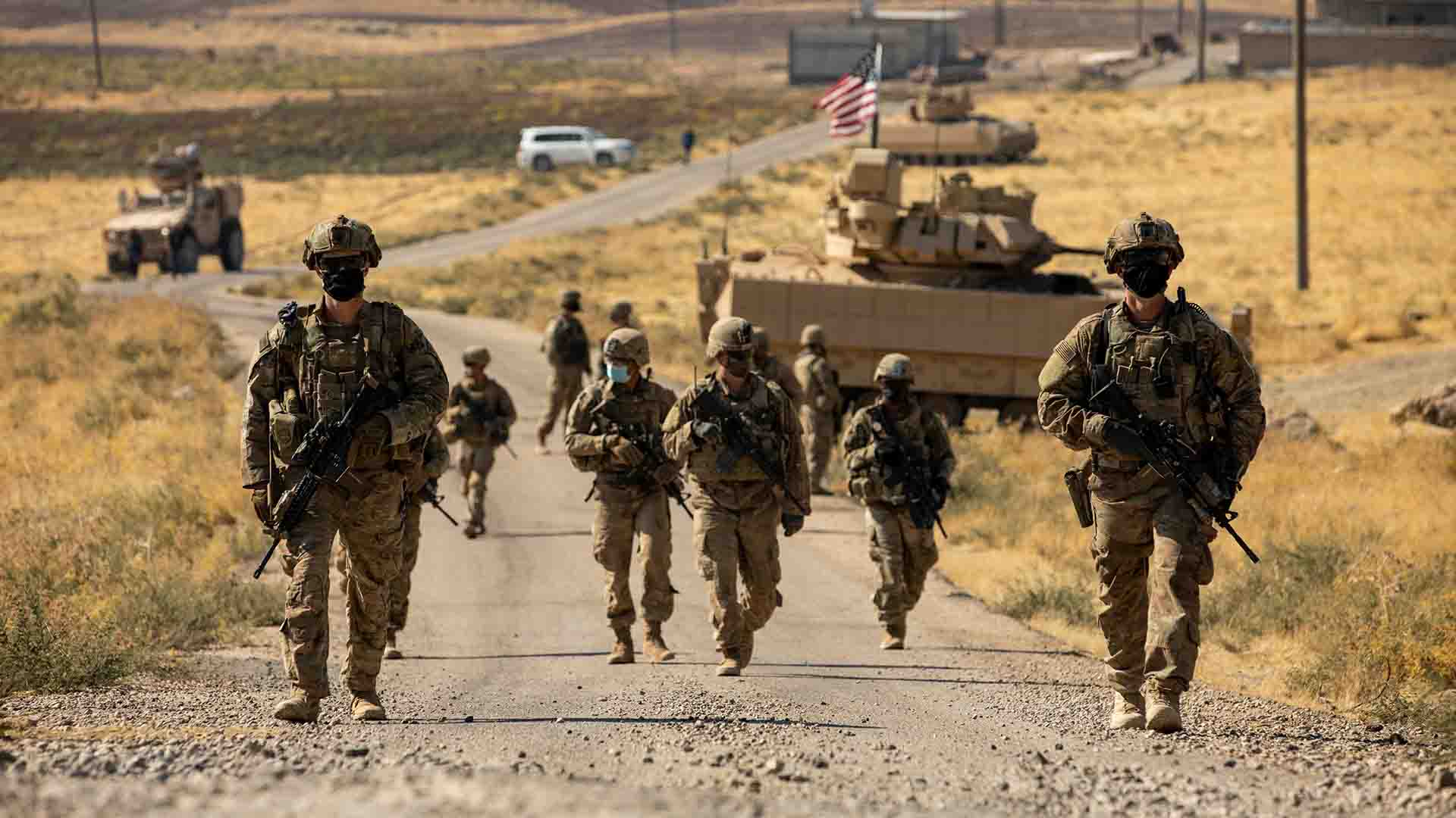 US soldiers accompanying Bradley Fighting Vehicle northeast Syria.